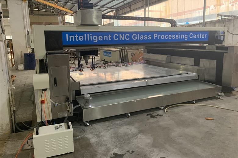 A new CNC glass processing equipment arrive BTG glass factory